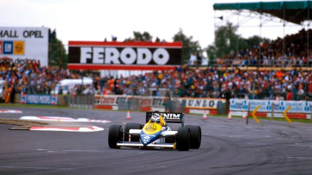 Keke Rosberg (Williams FW10 Honda) guns it out of the Woodcote chicane on his way to what at the time was the fastest ever qualifying lap.