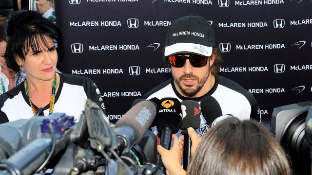 Fernando Alonso (ESP) McLaren talks with the media as Silvia Hoffer Frangipane, McLaren Press Officer looks on at Formula One World Championship, Rd10, Hungarian Grand Prix, Qualifying, Hungaroring, Hungary, Saturday 25 July 2015. &copy&#x3b; Sutton Motorsport Images