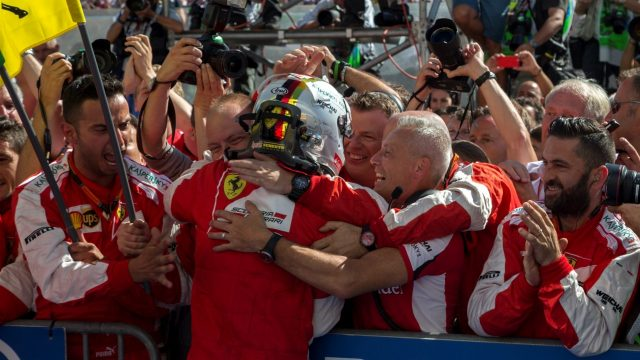Race winner Sebastian Vettel (GER) Ferrari celebrates with the team in parc ferme at Formula One World Championship, Rd10, Hungarian Grand Prix, Race, Hungaroring, Hungary, Sunday 26 July 2015. &copy&#x3b; Sutton Motorsport Images