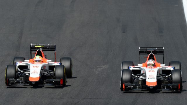 Roberto Merhi (ESP) Manor GP and Will Stevens (GBR) Manor GP battle at Formula One World Championship, Rd10, Hungarian Grand Prix, Race, Hungaroring, Hungary, Sunday 26 July 2015. &copy&#x3b; Sutton Motorsport Images