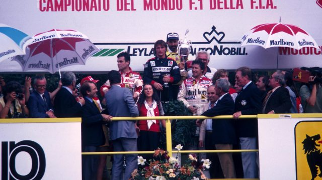 Mario Andretti (far right) is all smiles as he shares the podium with race winner Rene Arnoux and second placed Patrick Tambay. 1982 Italian Grand Prix, Monza. &copy&#x3b; Sutton Motorsport Images