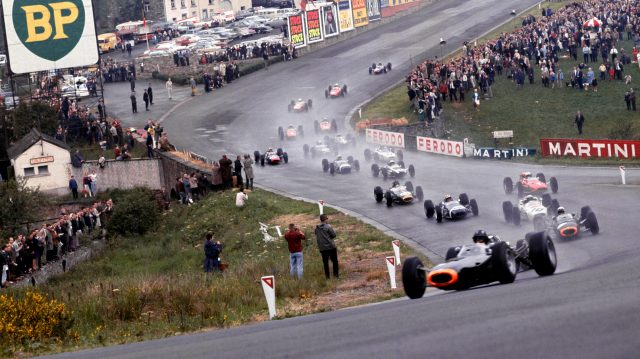 Graham Hill leads the field through Eau Rouge at the start of the 1965 Belgian Grand Prix. &copy&#x3b; LAT Photographic