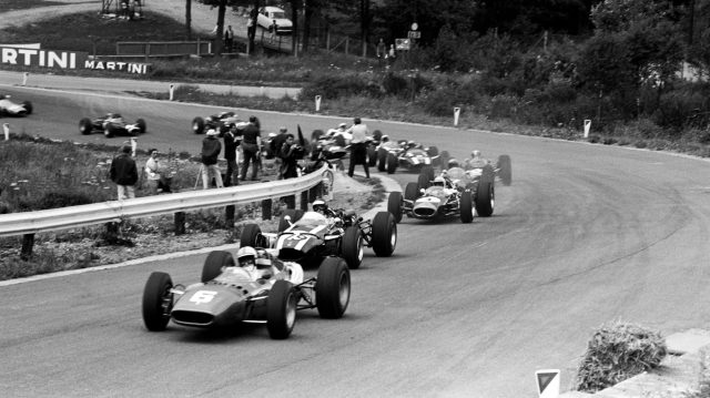 Pole sitter and race winner John Surtees (GBR) Ferrari 312 leads the field through Eau Rouge at the start of the race. Belgian Grand Prix, Spa-Francorchamps, 12 June 1966. &copy&#x3b; Sutton Motorsport Images