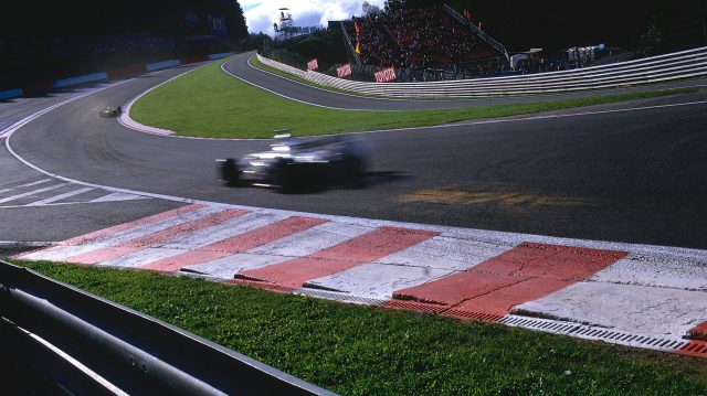 Cars fly through the newly revised Eau Rouge flat out in 2002. Patches are left where the wooden planks scrape the track surface. &copy&#x3b; LAT Photographic