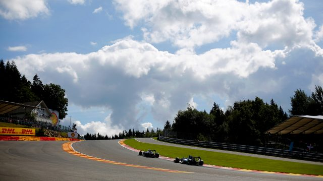 Jenson Button (GBR) McLaren MP4-29 leads Nico Rosberg (GER) Mercedes AMG F1 W05 through Eau Rouge in 2014. &copy&#x3b; Sutton Motorsport Images