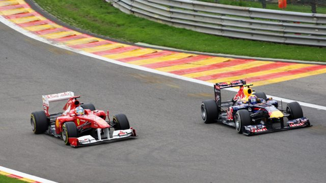 Mark Webber (right) completes a daring overtake on Fernando Alonso heading into Eau Rouge during the 2011 Belgian Grand Prix. © Sutton Motorsport Images