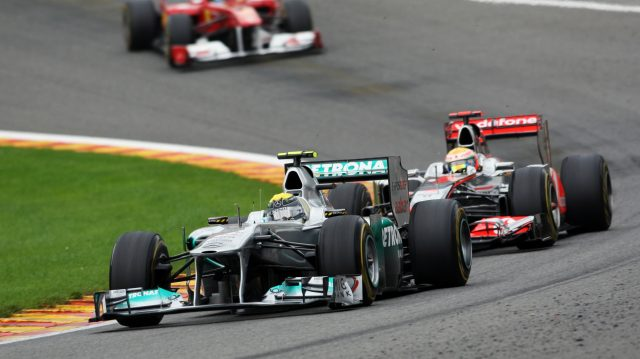 Nico Rosberg (Mercedes) battles with Lewis Hamilton (McLaren) through Eau Rouge. 2011 Belgian Grand Prix. &copy&#x3b; © Sutton Motorsport Images