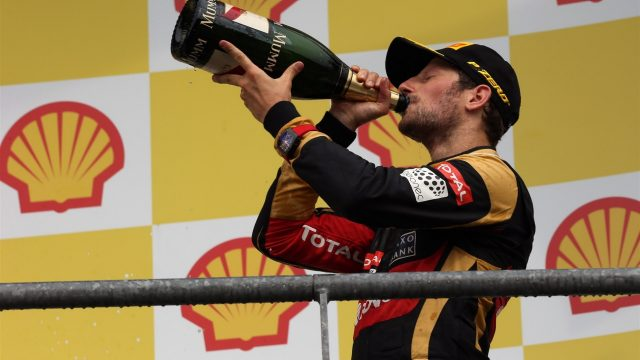 Romain Grosjean (FRA) Lotus F1 celebrates with the champagne on the podium at Formula One World Championship, Rd11, Belgian Grand Prix, Race, Spa Francorchamps, Belgium, Sunday 23 August 2015. &copy&#x3b; Sutton Motorsport Images