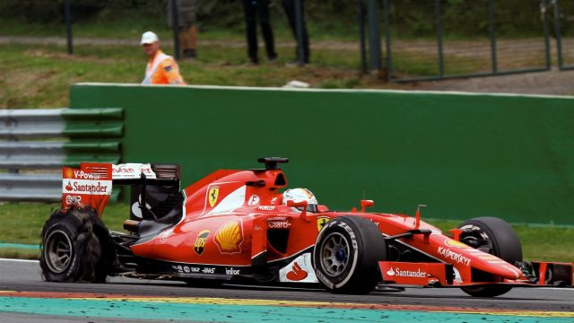 Sebastian Vettel (GER) Ferrari SF15-T with rear puncture at Formula One World Championship, Rd11, Belgian Grand Prix, Race, Spa Francorchamps, Belgium, Sunday 23 August 2015. &copy&#x3b; Sutton Motorsport Images