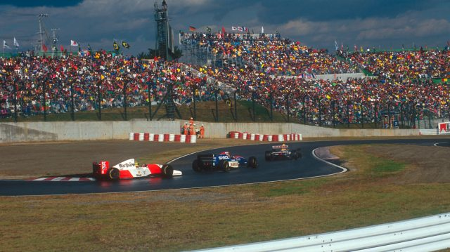 Eddie Irvine (middle car) unlapped himself from Ayrton Senna (rear car) going into Suzuka's famous chicane. &copy&#x3b; LAT Photographic