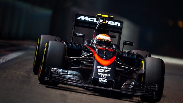 Jenson Button (GBR) McLaren MP4-30 at Formula One World Championship, Rd13, Singapore Grand Prix, Practice, Marina Bay Street Circuit, Singapore, Friday 18 September 2015. &copy&#x3b; Sutton Motorsport Images