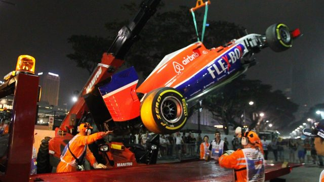 The car of Will Stevens (GBR) Marussia is recovered after crashing out in FP2 at Formula One World Championship, Rd13, Singapore Grand Prix, Practice, Marina Bay Street Circuit, Singapore, Friday 18 September 2015. &copy&#x3b; Sutton Motorsport Images