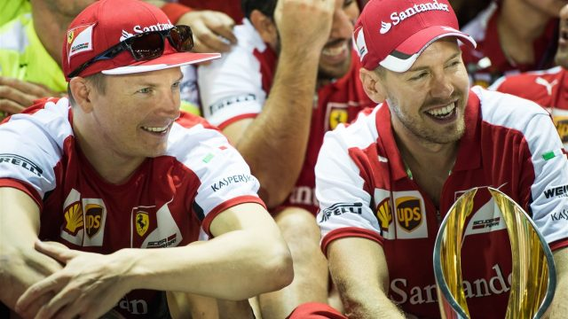 Kimi Raikkonen (FIN) Ferrari and race winner Sebastian Vettel (GER) Ferrari celebrate with the trophy at Formula One World Championship, Rd13, Singapore Grand Prix, Race, Marina Bay Street Circuit, Singapore, Sunday 20 September 2015. &copy&#x3b; Sutton Motorsport Images