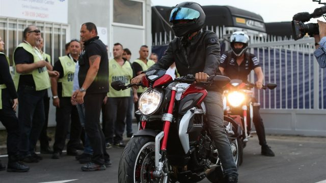 Lewis Hamilton (GBR) Mercedes AMG F1 arrives on a motorcycle at Formula One World Championship, Rd12, Italian Grand Prix, Preparations, Monza, Italy, Thursday 3 September 2015. &copy&#x3b; Sutton Motorsport Images