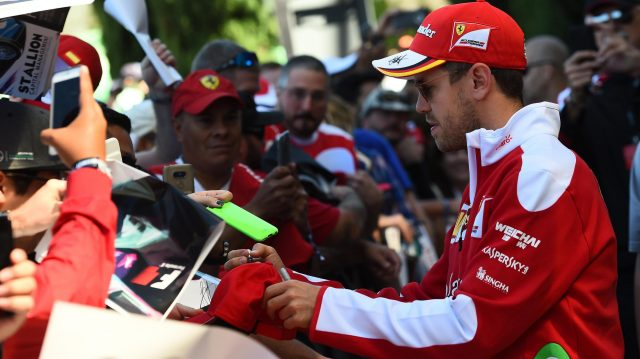 Sebastian Vettel (GER) Ferrari signs autographs for the fans at Formula One World Championship, Rd18, United States Grand Prix, Practice, Circuit of the Americas, Austin, Texas, USA, Friday 21 October 2016. &copy&#x3b; Sutton Images