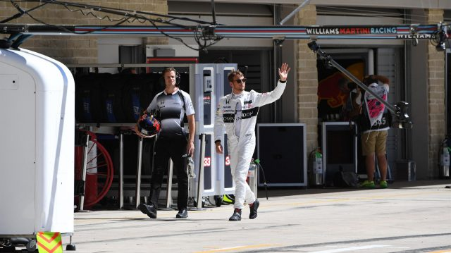 Jenson Button (GBR) McLaren with his trainer Mike Collier (GBR)  waves to the crowd after Q1 at Formula One World Championship, Rd18, United States Grand Prix, Qualifying, Circuit of the Americas, Austin, Texas, USA, Saturday 22 October 2016. &copy&#x3b; Sutton Images
