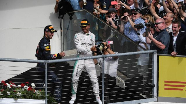 Lewis Hamilton (GBR) Mercedes AMG F1 and Daniel Ricciardo (AUS) Red Bull Racing celebrate on the podium with the champagne at Formula One World Championship, Rd18, United States Grand Prix, Race, Circuit of the Americas, Austin, Texas, USA, Sunday 23 October 2016. &copy&#x3b; Sutton Images