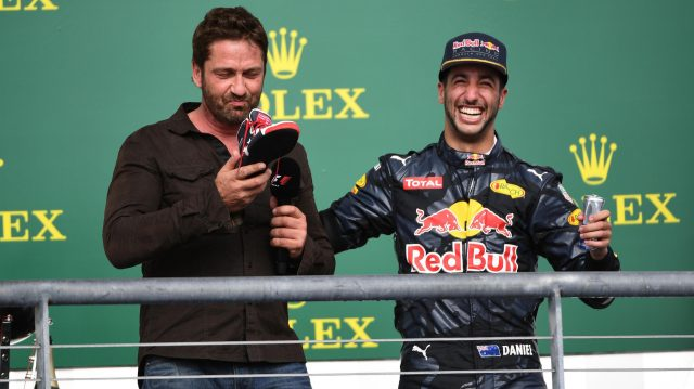Daniel Ricciardo (AUS) Red Bull Racing offers Gerard Butler (GBR) Actor a drink from his shoe on the podium at Formula One World Championship, Rd18, United States Grand Prix, Race, Circuit of the Americas, Austin, Texas, USA, Sunday 23 October 2016. &copy&#x3b; Sutton Images