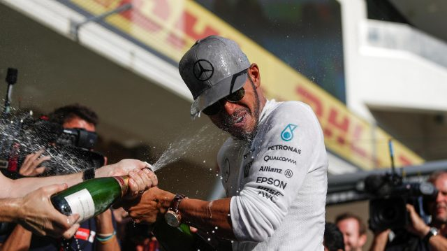 Race winner Lewis Hamilton (GBR) Mercedes AMG F1 celebrates with the team and the champagne at Formula One World Championship, Rd18, United States Grand Prix, Race, Circuit of the Americas, Austin, Texas, USA, Sunday 23 October 2016. &copy&#x3b; Sutton Images