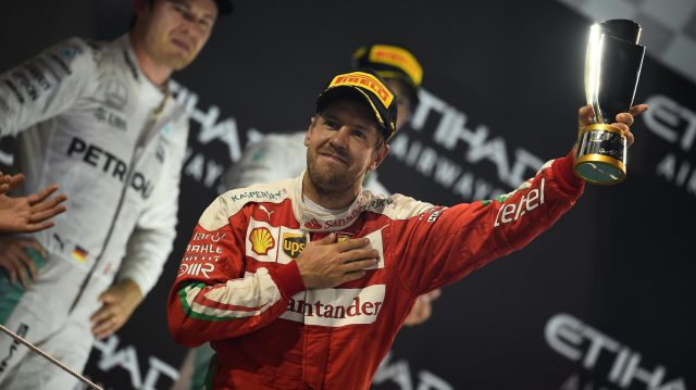 Sebastian Vettel (GER) Ferrari celebrates on the podium with the trophy at Formula One World Championship, Rd21, Abu Dhabi Grand Prix, Race, Yas Marina Circuit, Abu Dhabi, UAE, Sunday 27 November 2016. &copy&#x3b; Sutton Images