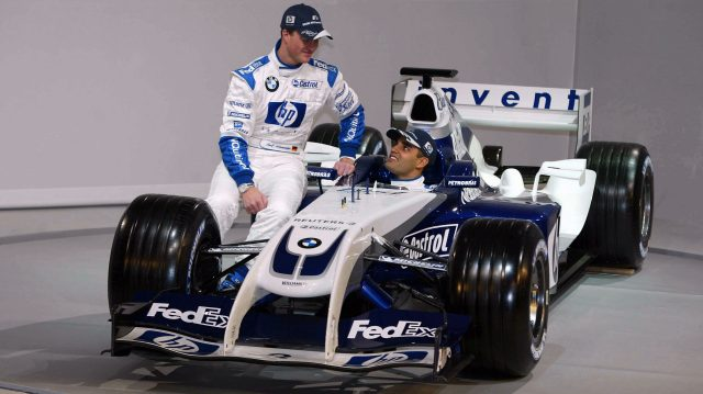 (L to R): Ralf Schumacher (GER) Williams and Juan Pablo Montoya (COL) Williams with the new Williams BMW FW26. Valencia, Spain, 5 January 2004. © Sutton Motorsport Images