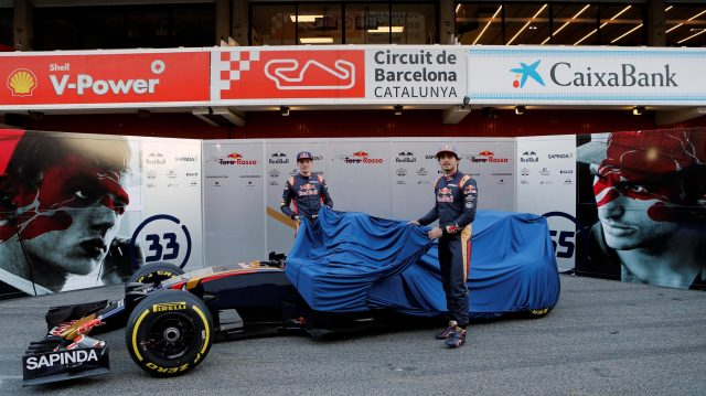 Carlos Sainz jr (ESP) Scuderia Toro Rosso and Max Verstappen (NED) Scuderia Toro Rosso take the covers off the Scuderia Toro Rosso STR11 at Formula One Testing, Day One, Barcelona, Spain, Tuesday 1 March 2016. &copy&#x3b; Sutton Motorsport Images