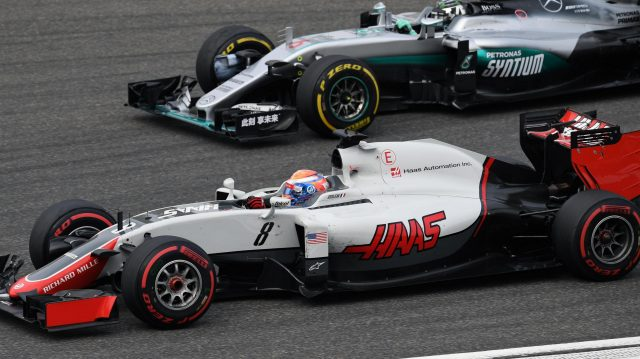 Romain Grosjean (FRA) Haas VF-16 and Nico Rosberg (GER) Mercedes-Benz F1 W07 Hybrid battle at Formula One World Championship, Rd3, Chinese Grand Prix, Practice, Shanghai, China, Friday 15 April 2016. &copy&#x3b; Sutton Motorsport Images