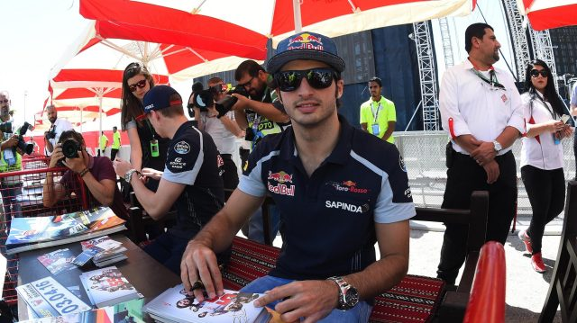 Carlos Sainz (ESP) Scuderia Toro Rosso at the autograph session at Formula One World Championship, Rd2, Bahrain Grand Prix Qualifying, Bahrain International Circuit, Sakhir, Bahrain, Saturday 2 April 2016. &copy&#x3b; Sutton Motorsport Images
