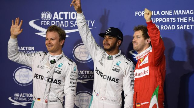 (L to R): Nico Rosberg (GER) Mercedes AMG F1, pole sitter Lewis Hamilton (GBR) Mercedes AMG F1 and Sebastian Vettel (GER) Ferrari celebrate in parc ferme at Formula One World Championship, Rd2, Bahrain Grand Prix Qualifying, Bahrain International Circuit, Sakhir, Bahrain, Saturday 2 April 2016. &copy&#x3b; Sutton Motorsport Images