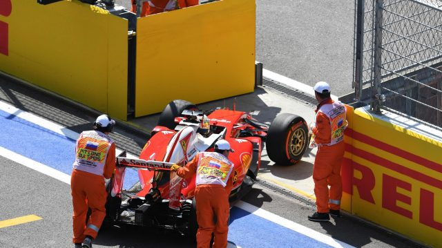 The car of Sebastian Vettel (GER) Ferrari SF16-H is pushed into pit lane by the marshals in FP2 at Formula One World Championship, Rd4, Russian Grand Prix, Practice, Sochi Autodrom, Sochi, Krasnodar Krai, Russia, Friday 29 April 2016. &copy&#x3b; Sutton Motorsport Images