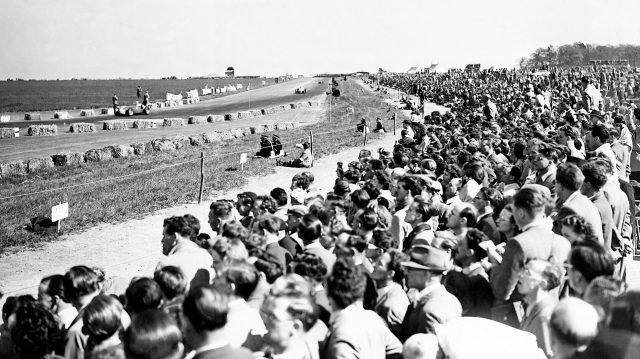 A huge crowd takes in the action. 1950 British Grand Prix