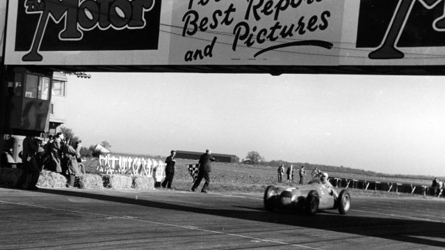 Giuseppe Farina (Alfa Romeo 158) 1st position, wins the first World Championship Grand Prix. 1950 British Grand Prix, Silverstone.
