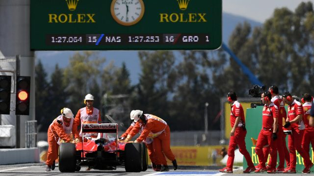 Sebastian Vettel (GER) Ferrari SF16-H is pushed in pit lane by the Ferrari mechanics after stopping at the end of pit lane in FP1 at Formula One World Championship, Rd5, Spanish Grand Prix, Practice, Barcelona, Spain, Friday 13 May 2016. &copy&#x3b; Sutton Motorsport Images