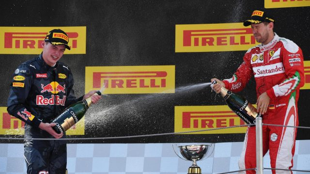 Race winner Max Verstappen (NED) Red Bull Racing celebrates on the podium with the Sebastian Vettel (GER) Ferrari and the champagne at Formula One World Championship, Rd5, Spanish Grand Prix, Race, Barcelona, Spain, Sunday 15 May 2016. &copy&#x3b; Sutton Motorsport Images