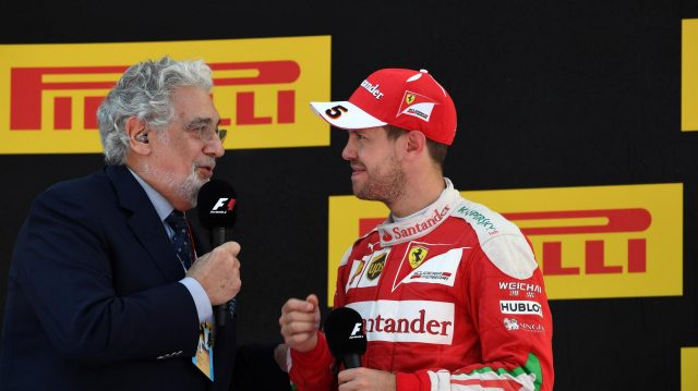 Placido Domingo (ESP) celebrates on the podium with Sebastian Vettel (GER) Ferrari at Formula One World Championship, Rd5, Spanish Grand Prix, Race, Barcelona, Spain, Sunday 15 May 2016. &copy&#x3b; Sutton Motorsport Images