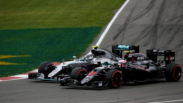 Nico Rosberg (GER) Mercedes-Benz F1 W07 Hybrid and Jenson Button (GBR) McLaren MP4-31 battle at Formula One World Championship, Rd7, Canadian Grand Prix, Race, Montreal, Canada, Sunday 12 June 2016. &copy&#x3b; Sutton Images