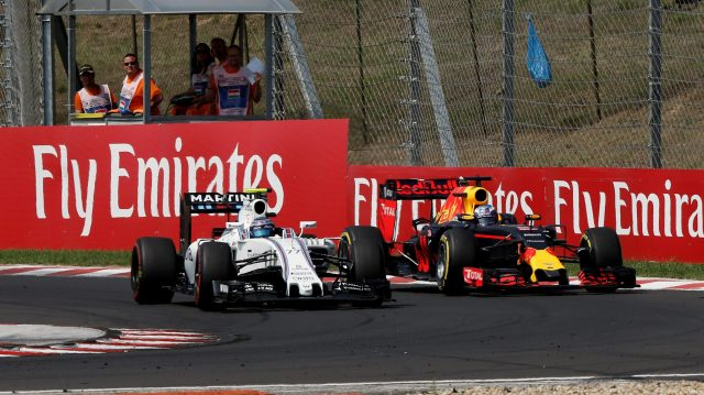 Valtteri Bottas (FIN) Williams FW38 and Daniel Ricciardo (AUS) Red Bull Racing RB12 battle at Formula One World Championship, Rd11, Hungarian Grand Prix, Race, Hungaroring, Hungary, Sunday 24 July 2016. &copy&#x3b; Sutton Images