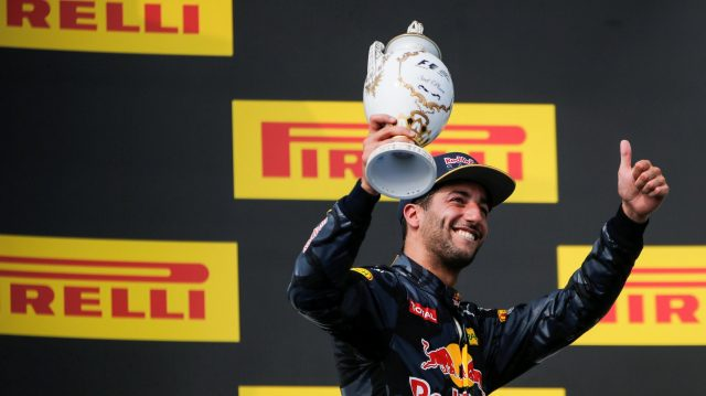 Daniel Ricciardo (AUS) Red Bull Racing celebrates on the podium with the trophy at Formula One World Championship, Rd11, Hungarian Grand Prix, Race, Hungaroring, Hungary, Sunday 24 July 2016. &copy&#x3b; Sutton Images