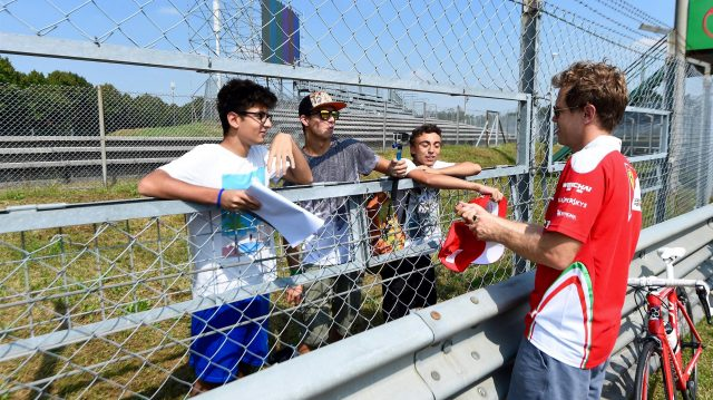 Sebastian Vettel (GER) Ferrari and fans and bike at Formula One World Championship, Rd14, Italian Grand Prix, Preparations, Monza, Italy, Thursday 1 September 2016. &copy&#x3b; Sutton Images