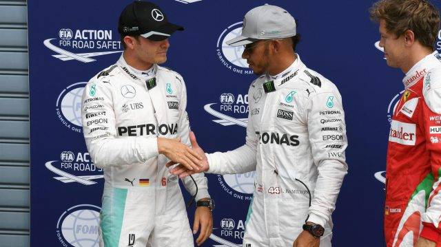 Pole sitter Lewis Hamilton (GBR) Mercedes AMG F1 and Nico Rosberg (GER) Mercedes AMG F1 celebrate in parc ferme at Formula One World Championship, Rd14, Italian Grand Prix, Qualifying, Monza, Italy, Saturday 3 September 2016. &copy&#x3b; Sutton Images