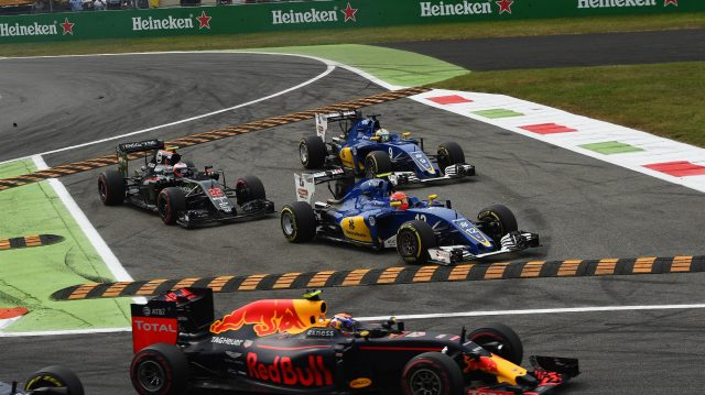 Jenson Button (GBR) McLaren MP4-31, Marcus Ericsson (SWE) Sauber C35 and Felipe Nasr (BRA) Sauber C35 run wide at the start of the race at Formula One World Championship, Rd14, Italian Grand Prix, Race, Monza, Italy, Sunday 4 September 2016. &copy&#x3b; Sutton Images