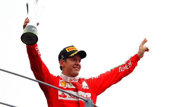 Sebastian Vettel (GER) Ferrari celebrates on the podium with the trophy at Formula One World Championship, Rd14, Italian Grand Prix, Race, Monza, Italy, Sunday 4 September 2016. &copy&#x3b; Sutton Images