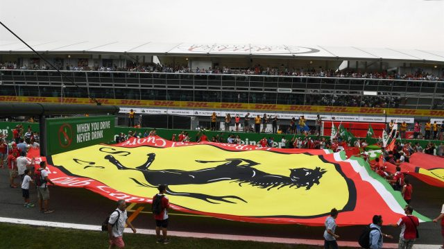 Fans and giant Ferrari flag on track at Formula One World Championship, Rd14, Italian Grand Prix, Race, Monza, Italy, Sunday 4 September 2016. &copy&#x3b; Sutton Images