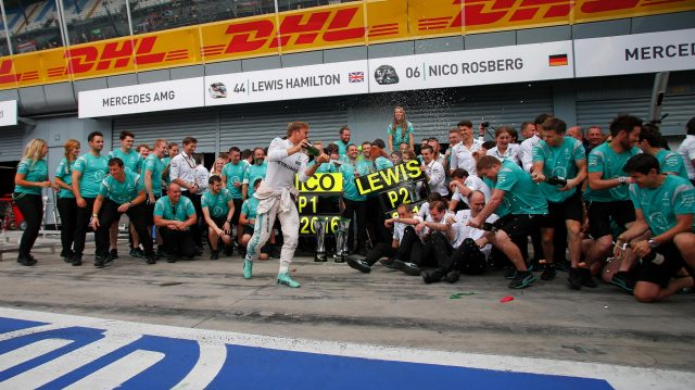 Race winner Nico Rosberg (GER) Mercedes AMG F1 celebrates wit hthe champagne and the team at Formula One World Championship, Rd14, Italian Grand Prix, Race, Monza, Italy, Sunday 4 September 2016. &copy&#x3b; Sutton Images