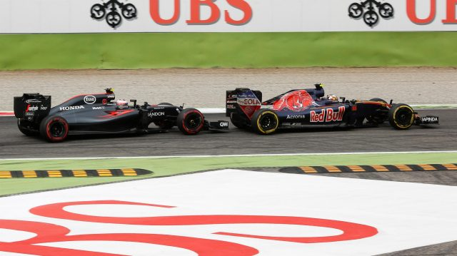 Jenson Button (GBR) McLaren MP4-31 and Carlos Sainz (ESP) Scuderia Toro Rosso STR11 battle at Formula One World Championship, Rd14, Italian Grand Prix, Race, Monza, Italy, Sunday 4 September 2016. &copy&#x3b; Sutton Images