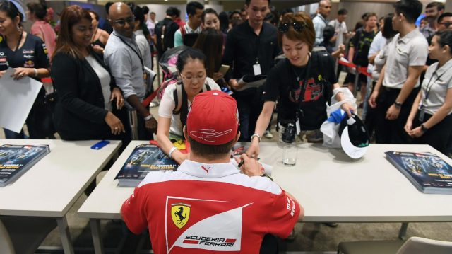 Kimi Raikkonen (FIN) Ferrari at the fans autograph session at Formula One World Championship, Rd15, Singapore Grand Prix, Preparations, Marina Bay Street Circuit, Singapore, Thursday 15 September 2016. &copy&#x3b; Sutton Images