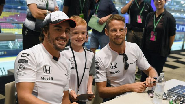 Fernando Alonso (ESP) McLaren and Jenson Button (GBR) McLaren at the fans autograph session at Formula One World Championship, Rd15, Singapore Grand Prix, Preparations, Marina Bay Street Circuit, Singapore, Thursday 15 September 2016. &copy&#x3b; Sutton Images