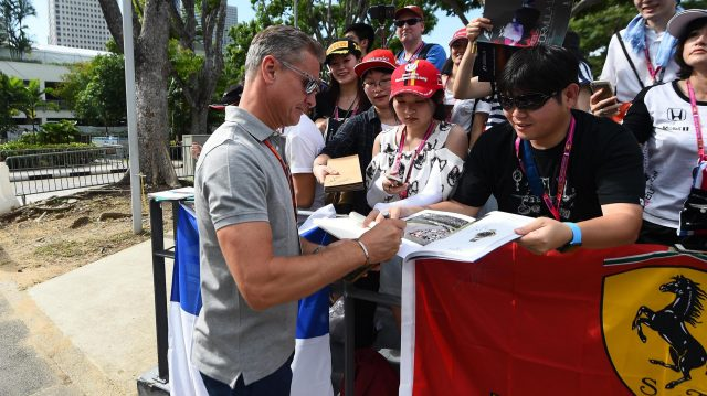 David Coulthard (GBR) Channel Four TV Commentator signs autographs for the fans at Formula One World Championship, Rd15, Singapore Grand Prix, Practice, Marina Bay Street Circuit, Singapore, Friday 16 September 2016. &copy&#x3b; Sutton Images