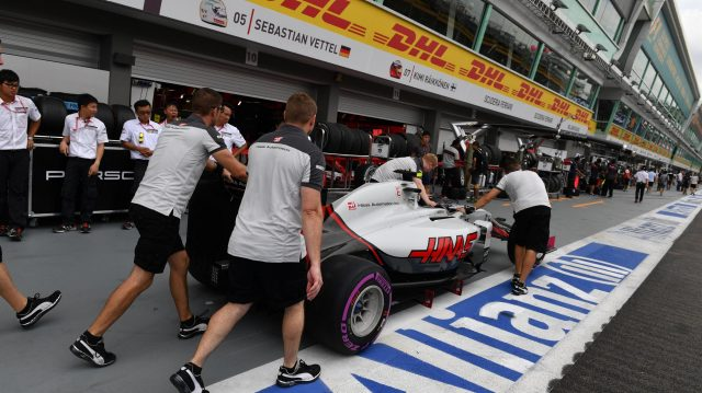 Haas VF-16 with Haas F1 mechanics in pit lane at Formula One World Championship, Rd15, Singapore Grand Prix, Qualifying, Marina Bay Street Circuit, Singapore, Saturday 17 September 2016. &copy&#x3b; Sutton Images