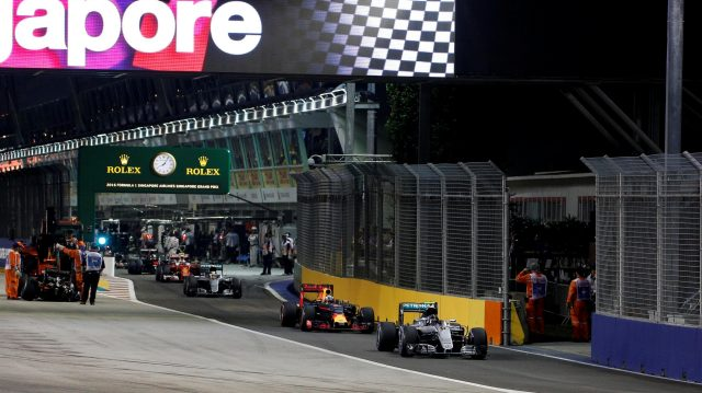 Nico Rosberg (GER) Mercedes-Benz F1 W07 Hybrid leads the cars through pit lane at Formula One World Championship, Rd15, Singapore Grand Prix, Race, Marina Bay Street Circuit, Singapore, Sunday 18 September 2016. &copy&#x3b; Sutton Images